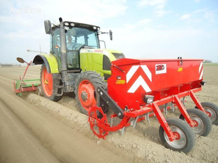 новая картофелесажалка  Устройство для внесения удобрений непосредственно в гребень